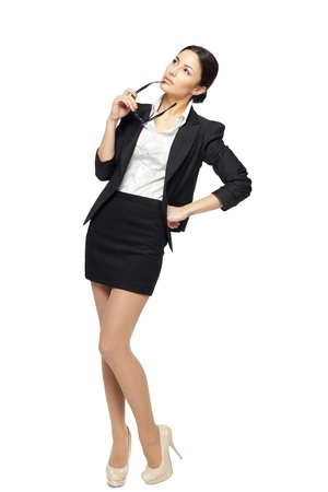 upwards: Full length of young business woman looking upwards, isolated on white background
