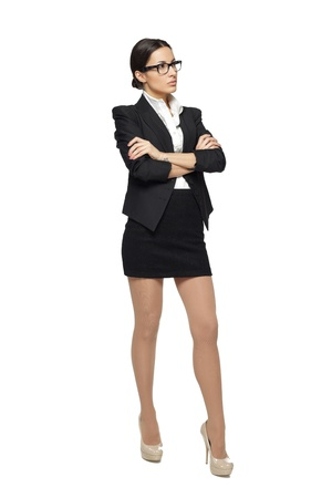 cross armed: Business woman standing in full length with folded hands looking sideways, isolated on white background