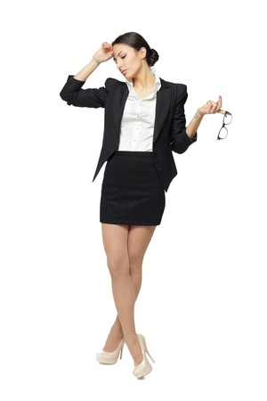 Full length of young business woman stressed, isolated on white background photo