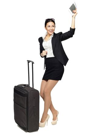 Young business woman happy because of the following trip isolated on white background photo