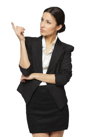 Young business woman pointing at white copy space, isolated on white background photo