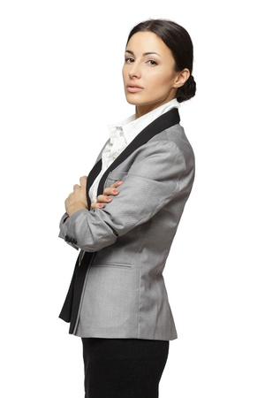 cross armed: Portrait of business woman standing with folded hands, isolated on white background Stock Photo