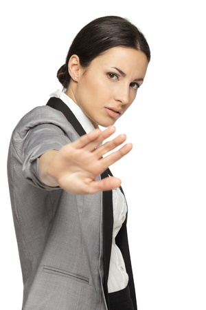 Stressed businesswoman making stop sign on white background, focus on business woman Stock Photo - 18303474
