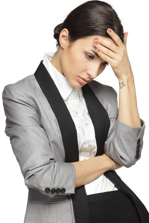 Young thinking business woman stressed, isolated on white background Stock Photo - 18303497
