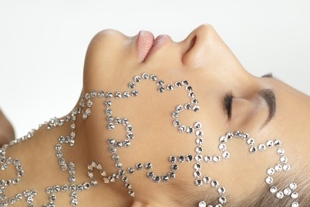 nude fashion model: Closeup of female with beauty crystal puzzle on her face