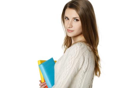 looking over shoulder: Closeup of calm woman holding a book, looking over shoulder, over white background