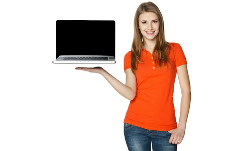 laptop stand: Happy casual female showing a laptop screen, isolated over a white background Stock Photo