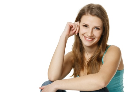 female elbow: Portrait of a pretty young woman sitting in front of a white background