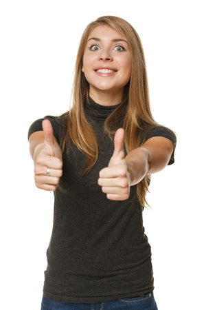Excited young success woman giving thumbs up over white background photo