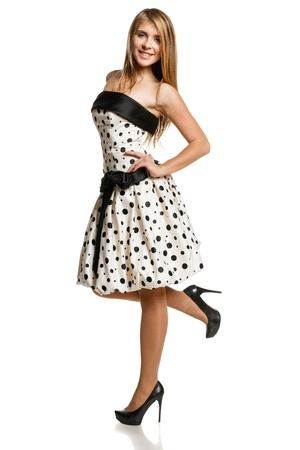 Flirty youn girl in romantic dress in full length, over white background photo