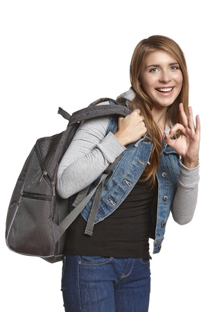 knapsack: Hiking  Excited girl hiker with backpack looking at camera and showing OK gesture