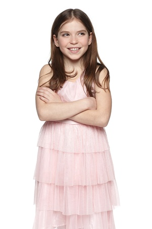 little girl dress: Smiling little girl in pink dress looking at blank copy space