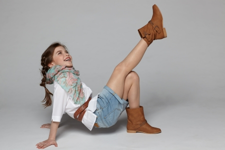 Little girl having fun on the studio floor