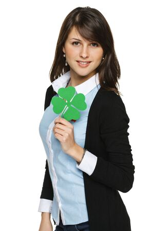 Young woman holding shamrock leaf, isolated on white background photo