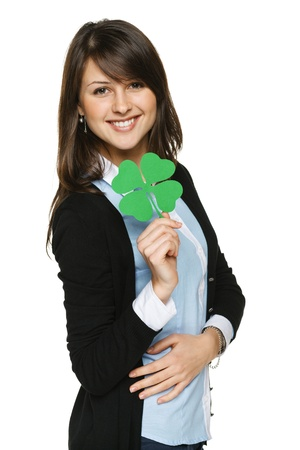 human's arm: Smiling young woman holding shamrock leaf, isolated on white background