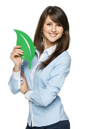 Closeup portrait of a beautiful happy young woman holding eco leaf photo