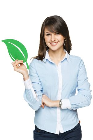 Smiling business woman holding eco leaf isolated on white background photo