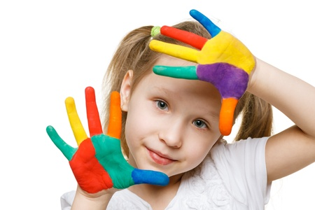 Little girl with painted fingers photo
