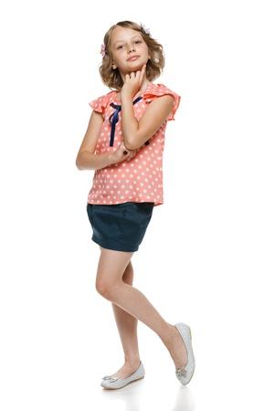 10 12 years: Little girl standing in full length, over white background Stock Photo