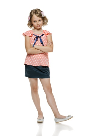 10 12 years: Little girl standing with folded hands in full length, over white background