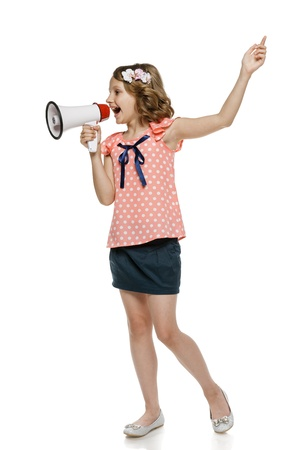 10 to 12 years: Little girl screaming into megaphone Stock Photo