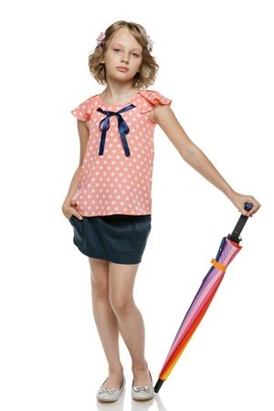 10 12 years: Little girl standing with umbrella  Stock Photo