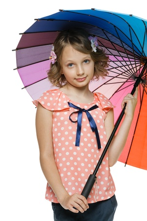 10 12 years: Closeup of little girl standing under colorful umbrella, over white background