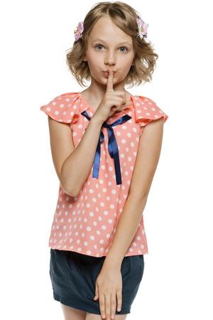 finger to lips: Little girl with finger on lips
