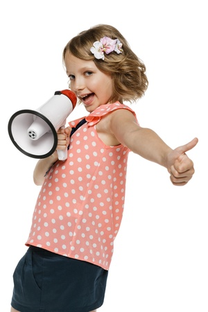 10 to 12 years: Expressive little girl with megaphone showing thum up sign