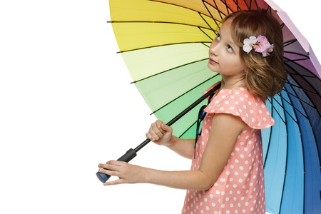10 12 years: Little girl standing undre umbrella looking to the blank copy space