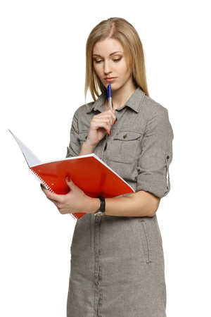 Pensive woman making notes Stock Photo - 19203419