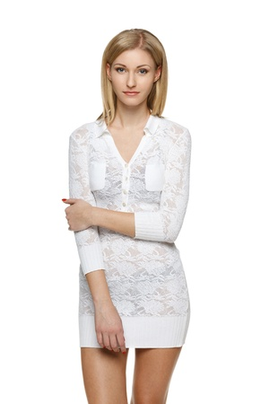 Young woman in white lacy dress over white background photo
