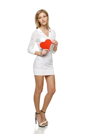 Full length of young  woman in white lacy dress holding heart shape over white background Stock Photo - 19203395
