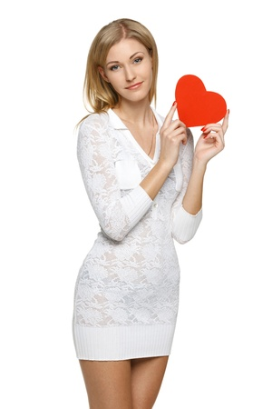Smiling woman in white lacy dress holding heart shape over white background Stock Photo - 19203404