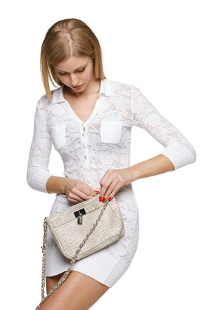 Woman closing her handbag, over white background Stock Photo - 19203408