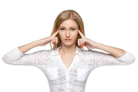 Woman with fingers in ears photo