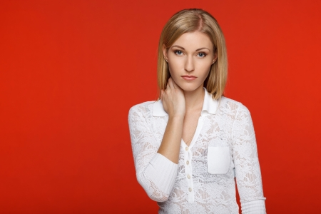 Closeup of a woman in white over red background photo