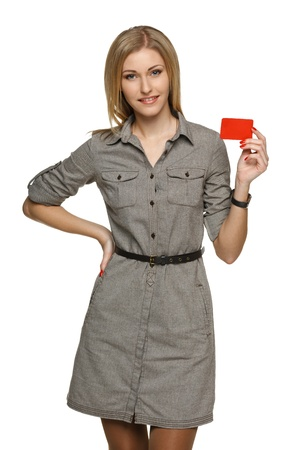 Smiling business woman holding credit card isolated on white background photo