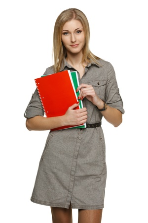 Woman holding notebooks, over white background photo