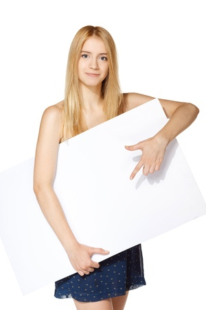 Girl pointing at a blank board photo