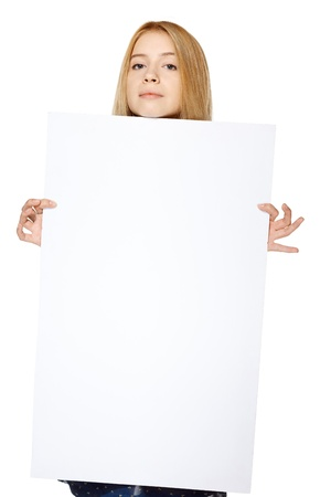 Calm teenage girl holding peeking out the adge of blank banner, over wgite background Stock Photo - 19427304