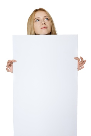 Teenage girl holding blank banner and looking up, over white background Stock Photo - 19427309