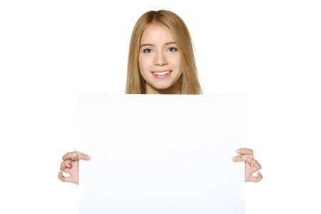 Smiling teen girl holding blank white paper isolated on white background Stock Photo - 19427311