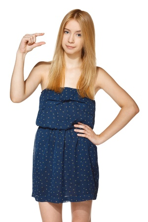 Young woman holding empty copy space in her fingers, over white background Stock Photo - 19427308