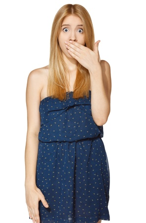 Shocked girl covers her mouth with hands, isolated on white photo