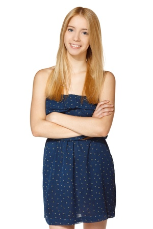 sundress: Smiling female standing with folded hands, over white background