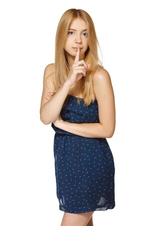 noiseless: Beautiful young woman with finger on lips over white background