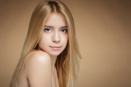 Closeup of tender girl over beige background photo
