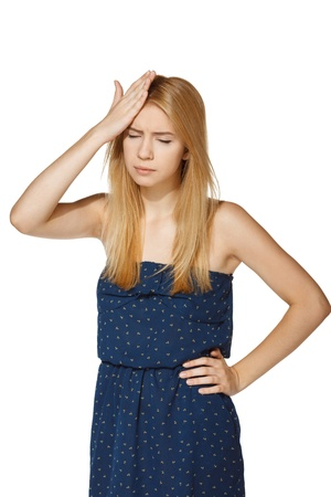 sore eye: Unhappy woman with her hand on her forehead, over white background