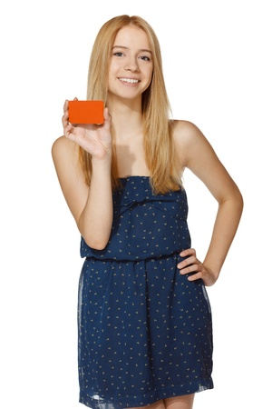 Young joyful woman holding blank credit card, over white background photo